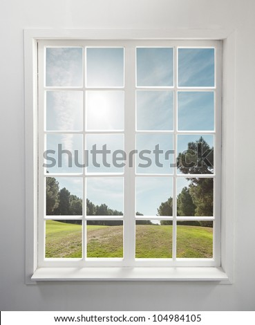 Modern residential window and trees and sky behind - stock photo
