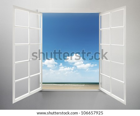 Modern residential window open with ocean view and clouds - stock photo