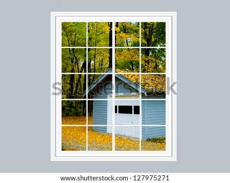 Modern residential window with view of cabin with fall color