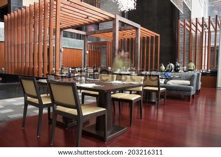 Modern restaurant interior, part of a hotel - stock photo