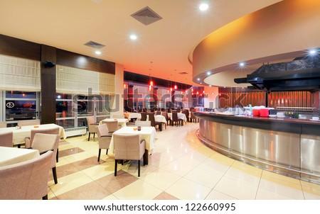 Modern restaurant interior, part of a hotel, night scene. - stock photo