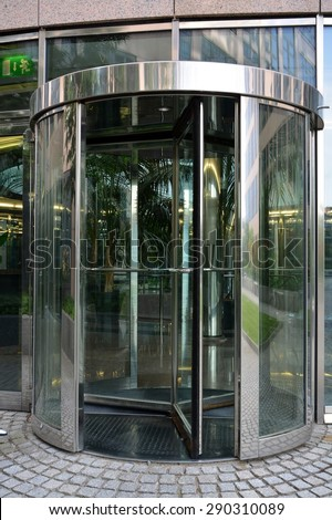 Modern revolving door as entrance to office building or hotel - stock photo