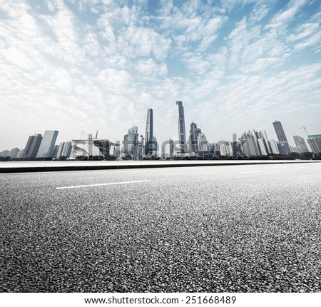 modern road with skyline and cityscape background - stock photo