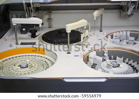 modern robotical machine for centrifuge blood and urine testing - stock photo