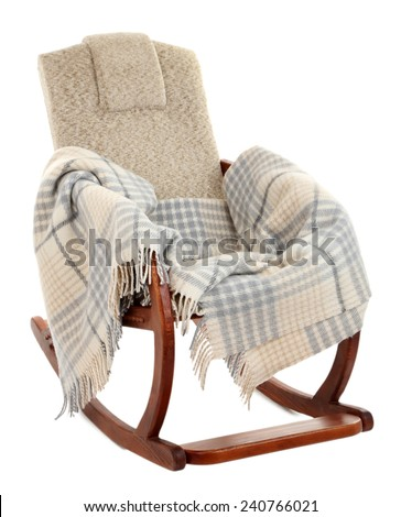 Modern rocking-chair with rug isolated on white - stock photo