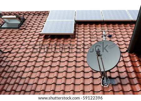 modern roof with satellite dish and solar panels - stock photo