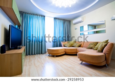 Modern room interior with TV and sofa - stock photo