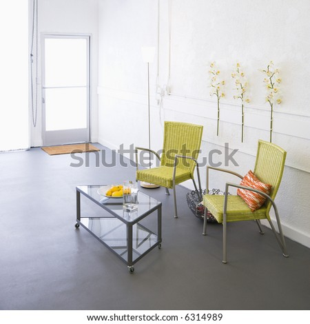 Modern room with arm chairs and coffee table. - stock photo