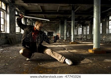 modern samurai in industrial place - stock photo
