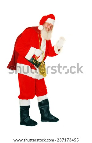 Modern Santa Claus holds his Bag of presents as he waves. Isolated on white with room for your text. Santa Claus is a mythical figure some say, others believe in Santa Clause and say they saw him. - stock photo