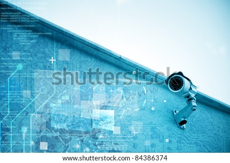Modern security camera for surveillance - stock photo