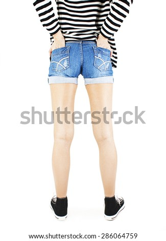 Modern sexy girl in shorts and striped sweatshirt. The model is back. Great ass. Isolated on white background   - stock photo
