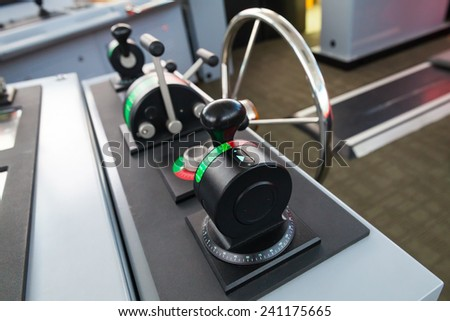 Modern ship control panel with steering wheel on the captains bridge - stock photo