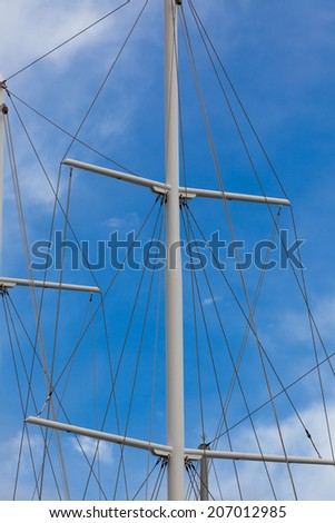 Modern Ship masts without sails. Vertical shot