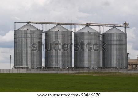 four farm grain silos agriculture stock photo 66675382. Black Bedroom Furniture Sets. Home Design Ideas