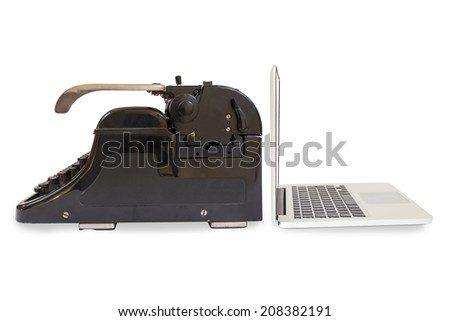 Modern silver laptop and an old black typewriter isolated on white background - stock photo