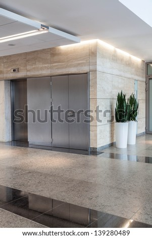 Modern silver lift in a new office building - stock photo