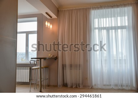 Modern, simple interior design in light apartments - stock photo