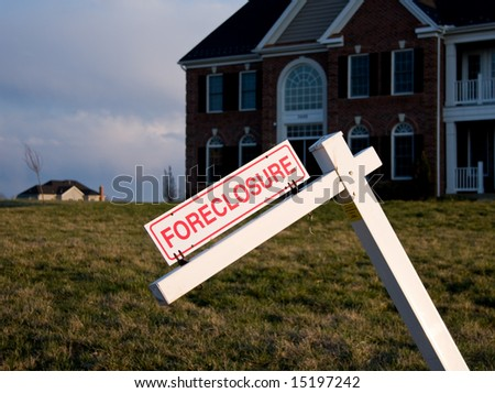 Modern Single Family House with tilted foreclosure sign - stock photo