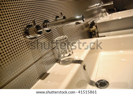 Modern sink and tap design in a hotel room