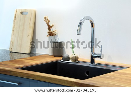 Modern sink with decoration in kitchen room. - stock photo