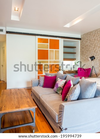 Modern sitting-room interior decorated with vintage furniture - stock photo