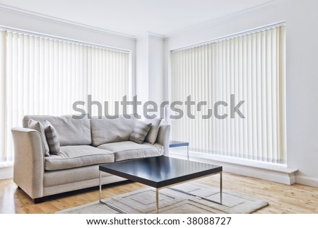 modern sitting room with designer sofa and coffee table - stock photo