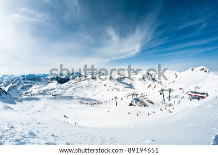 modern ski resort in mountains - stock photo