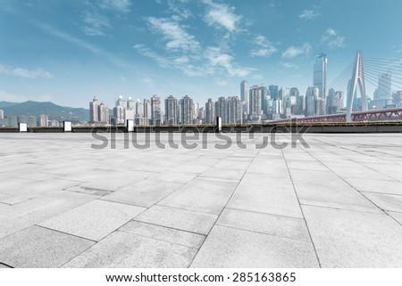modern skyline and empty road - stock photo