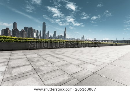 modern skyline and empty road - stock photo