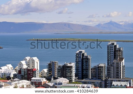 Modern skyline of Reykjavik, the capital of Iceland, towards the Atlantic Ocean. - stock photo