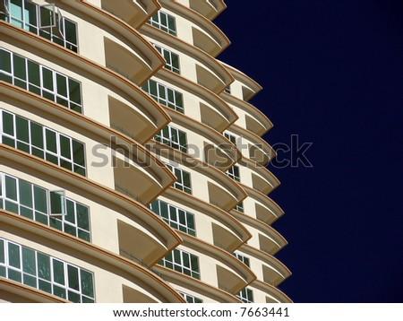 Modern skyscraper at beach side,closeup - stock photo