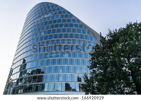 Modern skyscraper in London at sunset. - stock photo