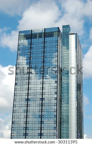 Modern skyscraper reflecting the sky - stock photo