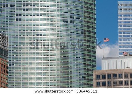 Modern skyscraper with US flag in Manhattan, New York City. - stock photo