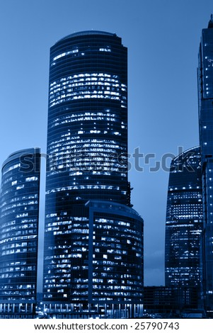 Modern skyscrapers at night toned in a blue color - stock photo
