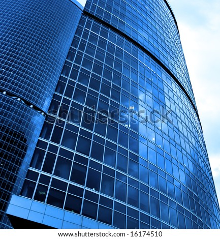 Modern skyscrapers close-up toned in blue color - stock photo