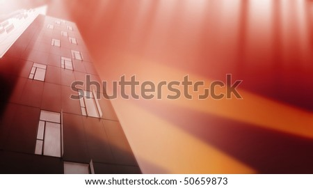 Modern skyscrapers covered with orange light. - stock photo