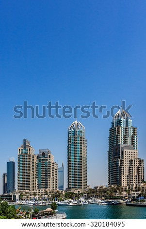 Modern skyscrapers in Dubai (emirate and city). Dubai now boasts more completed skyscrapers higher than 0,8 - 0,25 km than any other city. United Arab Emirates. - stock photo