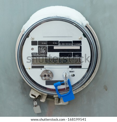 Modern smart grid residential digital power supply meter displays kilowatthours of consumed electric energy - stock photo