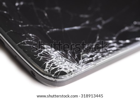 modern smartphone with cracked screen in one corner, isolated on white background - stock photo