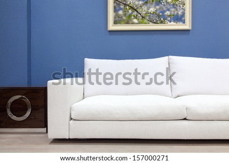 Modern sofa in a house interior - stock photo