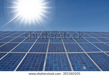 Modern solar panel with bright sun, alternative energy concept