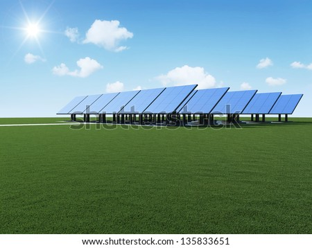 Modern Solar Panels Farm on beautiful green grass with sun and clouds. Alternative Energy Concept - stock photo