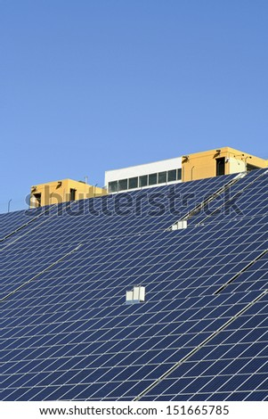 Modern solar photo voltaic panels with great blue cells with perspective view. Great for energy and environment themes. - stock photo