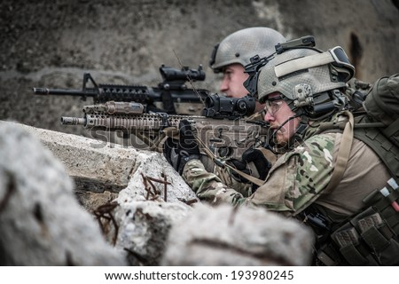 modern soldiers defending their position, in ruins - stock photo