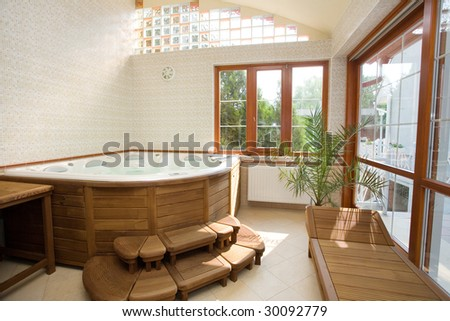 modern spa interior with jacuzzi - stock photo