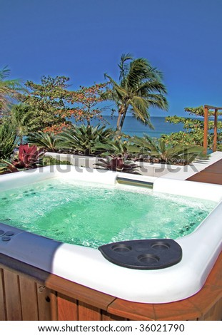 modern spa jacuzzi outdoors under beautiful blue sky - stock photo