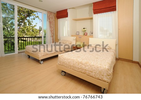Modern Spacious Bedroom view of natural light. - stock photo