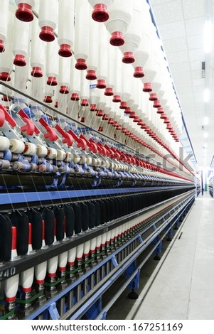 Modern spinning machine is working in the workshop   - stock photo